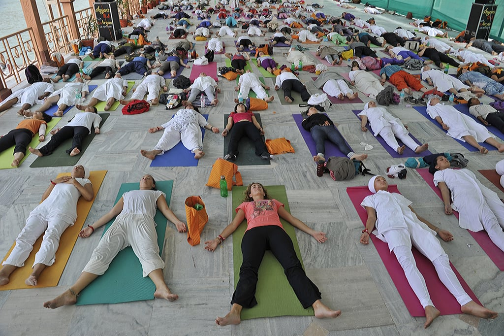 Yogis from 36 countries kicked off the International Yoga Festival in Rishikesh, India, with over 300 people performing the ancient exercise together. Not enough to beat the 10,000 yogis who practiced in Central Park last Summer, but yoga isn't about competition, right? It's about judgment.