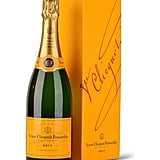 """""""You seriously cannot go wrong with a Champagne gift… I know it is one I love to receive! The great this about Veuve is the bottles are so chic – you can pop it open to celebrate or just have on display on a bar cart or fireplace display.  For the holidays and gift giving – why not 'go big' and go for the Magnum bottle. I know I would be in heaven if I received that!""""  Veuve Clicquot, Brut Yellow Label (Magnum)  ($50)"""