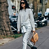 Wear shiny metallic pants with a go-to knit jumper and Dr. Martens platform boots.