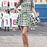 Miranda Kerr stepped out in Sydney looking pretty and playful in a colorful Peter Pilotto fit-and-flare and strappy white sandals.