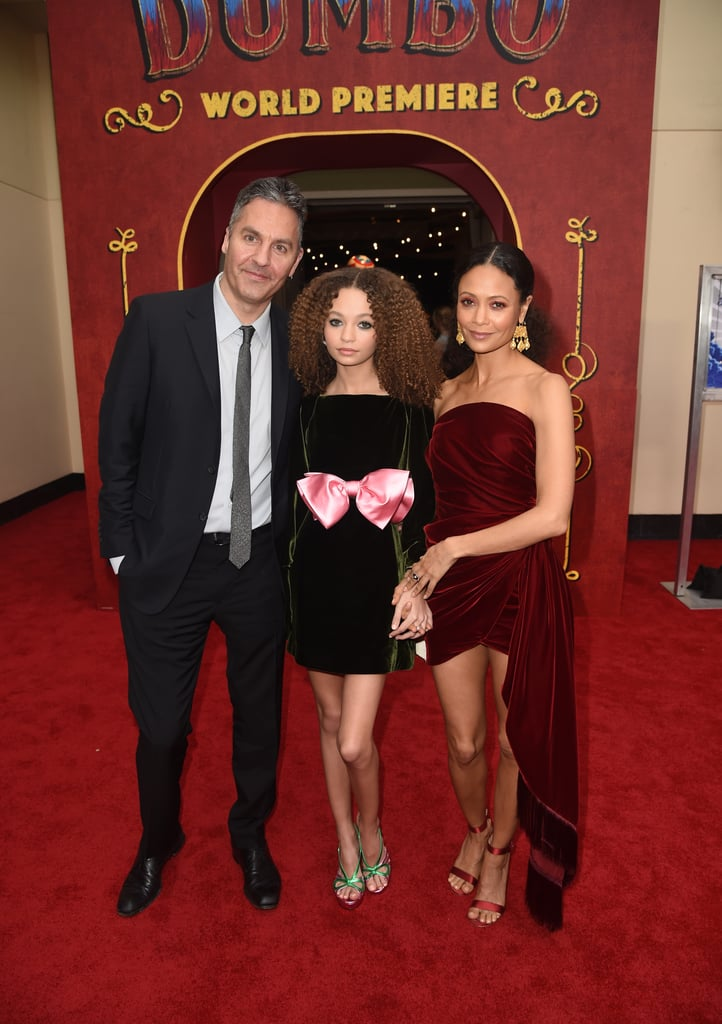 "Thandie Newton has one seriously gorgeous family! On Monday, the 46-year-old actress and husband Ol Parker stepped out to support their youngest daughter, 14-year-old Nico, at the LA premiere of her new movie, Dumbo. Thandie and Ol beamed with pride as they posed with Nico on the red carpet and linked up with her costar Colin Farrell. Also in attendance were Angelina Jolie and her youngest kids, but missing from the fun were Thandie and Ol's 18-year-old daughter, Ripley, and 5-year-old son, Booker. The Tim Burton-directed film is a remake of the 1941 Disney classic and marks Nico's debut into the acting world. Despite the fact that Nico's parents are both in the entertainment industry (Thandie stars in HBO's Westworld, while Ol is a film writer and director), the 14-year-old initially wasn't interested in acting. ""I'd only seen it as, like, the cool thing that my mum does sometimes,"" she previously told The Hollywood Reporter. However, that all changed once she auditioned for Dumbo. ""I was really proud of it when doing it and I was really confident in myself . . . from there I thought, 'This may be what I want to do when I'm older.'"" The film also stars Eva Green, Michael Keaton, and Danny DeVito. Catch it in theaters on March 29!      Related:                                                                                                           12 Sweet Photos of Thandie Newton's Seriously Stunning Family"