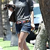 Rachel Bilson visited a friend in Hollywood sporting a pair of denim shorts, a gray sweater, colorful belt, and her favorite Martin Margiela nude sandals.