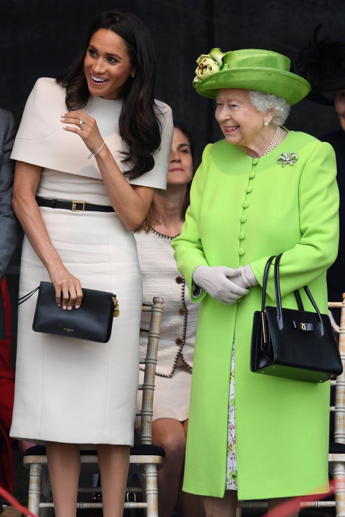 For her first official engagement with Queen Elizabeth in June 2018, Meghan wore a caped Givenchy design. She simply accessorised her outfit with a chic black and gold belt and a matching clutch, pearl earrings, Sarah Flint pumps, and the all-important tights.