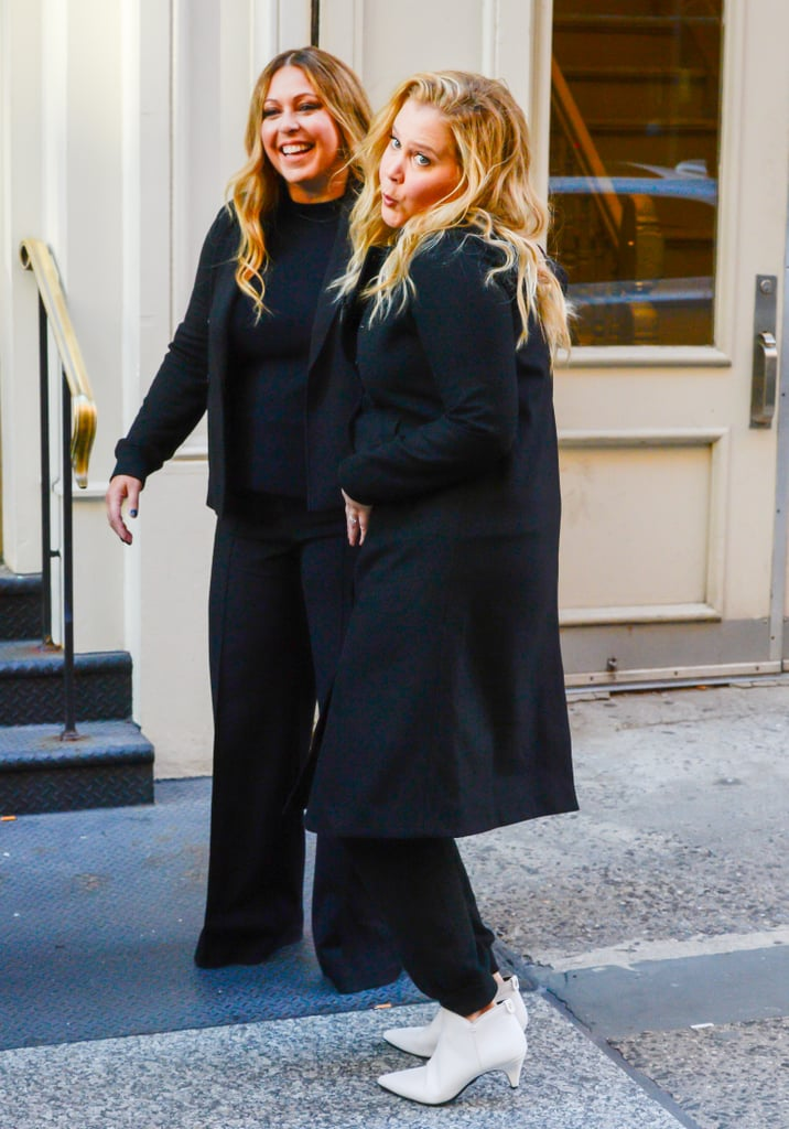 "Amy Schumer is going to be a mum! After revealing that she's expecting her first child with husband Chris Fischer earlier this week, the actress was spotted doing a photoshoot in NYC on Thursday. In addition to laughing it up on the street, Amy playfully cradled her stomach for photographers. Naturally, the comedian has already been cracking jokes about her pregnancy. In addition to photoshopping herself and Chris on a picture of Prince Harry and Meghan Markle — who are also expecting their first child — she has been documenting the ""joys"" of morning sickness. See more photos from her latest outing ahead.       Related:                                                                                                           All the Celebrities Who Will Be Bringing Home New Babies in 2018"