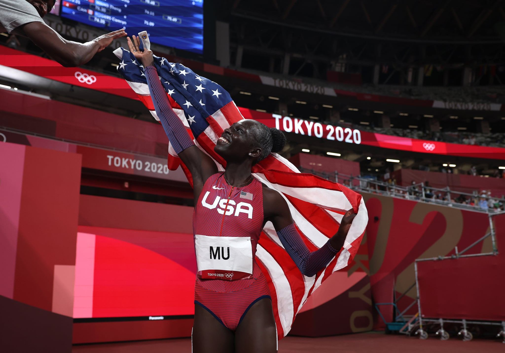TOKYO, JAPAN - AUGUST 03: Athing Mu of Team United States reacts after winning the gold medal in the Women's 800m Final on day eleven of the Tokyo 2020 Olympic Games at Olympic Stadium on August 03, 2021 in Tokyo, Japan. (Photo by Patrick Smith/Getty Images)