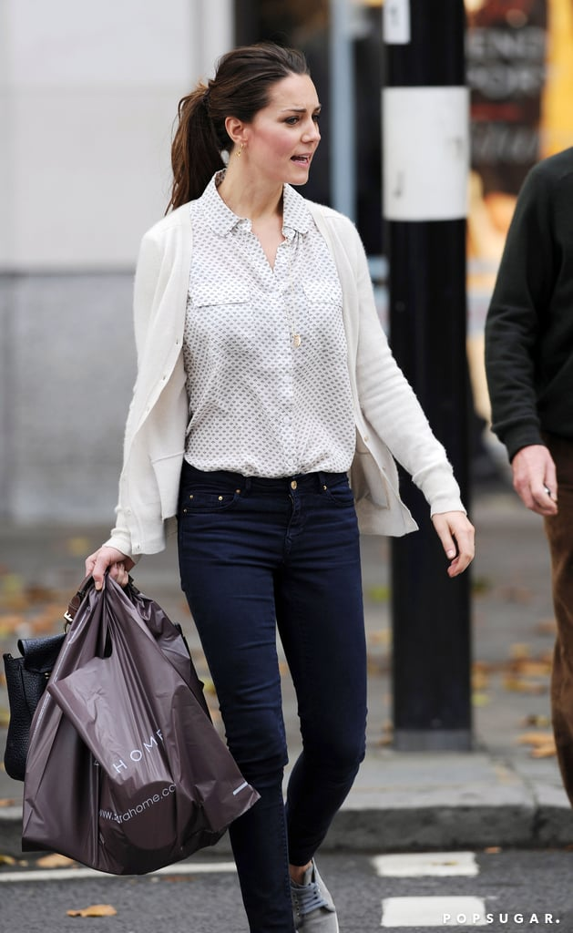 You won't see Kate Middleton's casual Friday anywhere else! Kate squeezed in a bit of home shopping in London today after wrapping up a very busy week. The Duchess of Cambridge looked comfortable in skinny jeans and sneakers as she walked around the Chelsea neighborhood with a male companion while carrying shopping bags from Zara Home. Kate may have been buying items for her new royal apartments in Kensington Palace, which she, Prince William, and Prince George just recently moved into. On Wednesday, Kate and her family made headlines when they held a christening for Prince George at St. James's Palace. Guests included the queen, Prince Harry, Pippa Middleton, and other close members of William and Kate's family. The couple also announced that they had selected seven godparents for Prince George, including Zara Tindall, William's cousin who is expecting a baby of her own; Julia Samuel, one of Princess Diana's close friends; and several former schoolmates. On Thursday, Kate attended the 100 Women in Hedge Funds gala, her first official party since moving from Wales to London this Summer. She didn't have to travel very far to the bash as it was held in the State Apartments at her home in Kensington Palace.