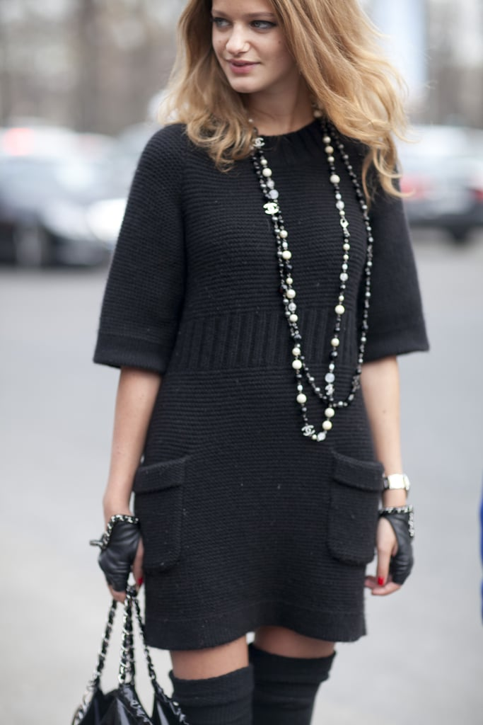 Layered beaded necklaces and studded gloves gave this all-black look added edge.