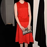 She chose a sleek red Calvin Klein ensemble, punched up with a metallic-hued clutch, for the designer's Fall 2012 runway show in February.