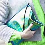 We love how the iridescent clutch popped against this neon green sweater.