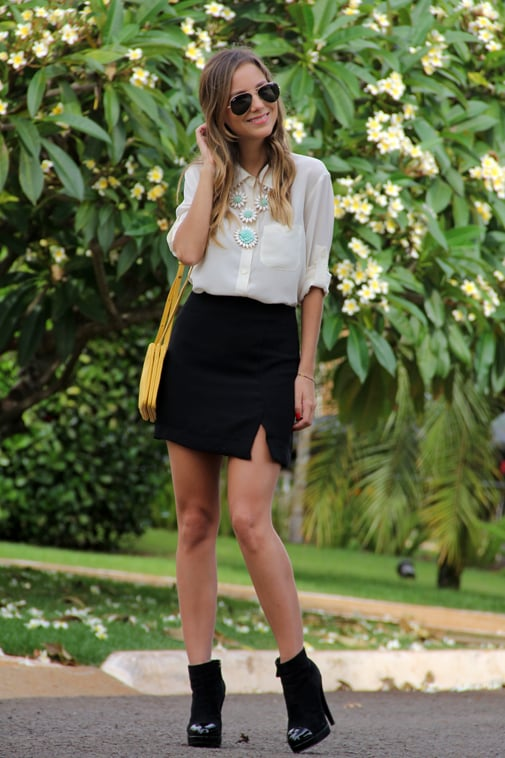Toughen up a silky blouse and miniskirt with platform booties. Source: Lookbook.nu