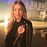 Gigi showed off her Versace leather jacket before the show!