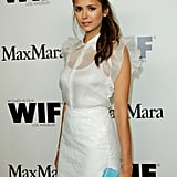 Nina Dobrev wore her hair up to the event.