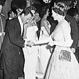 Frank Sinatra bowed to Queen Elizabeth II as she arrived for the premiere of Me and the Colonel in 1958.