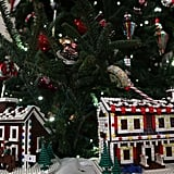 Fifty-six Lego gingerbread houses are nestled in tree branches throughout the State Dining Room.