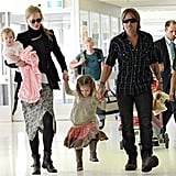 Nicole Kidman and Keith Urban in the airport with daughters Sunday and Faith.
