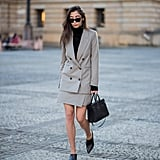 Where you'd normally fit in classic pumps — i.e. with a skirt suit — substitute your mules for an unexpected style twist.
