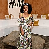Yara Shahidi wearing a floral dress, Raen sunglasses, and flats at the H&M Loves Coachella tent.