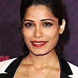 Freida Pinto wore a bright red lipstick on the Chime For Change red carpet with dark eye makeup.