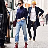 Earlier that month, she accessorised her fairly simple outfit with a pair of burgundy booties.