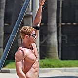Kellan Lutz showed off on the playground equipment.