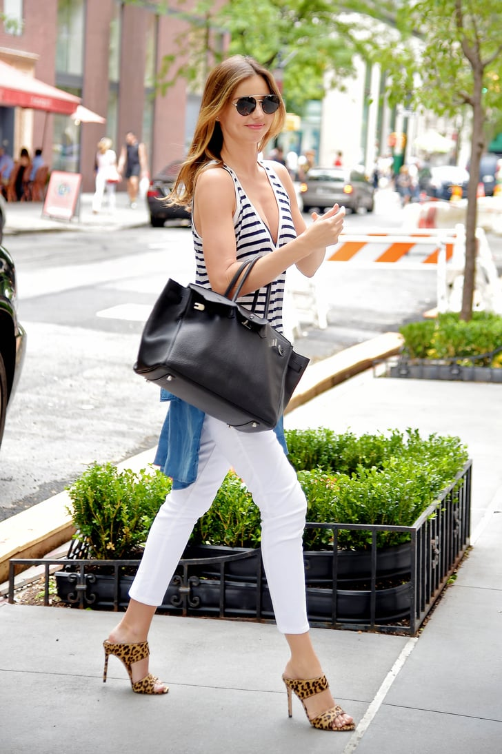 Miranda Kerr wearing Miu Miu mules out in New York.