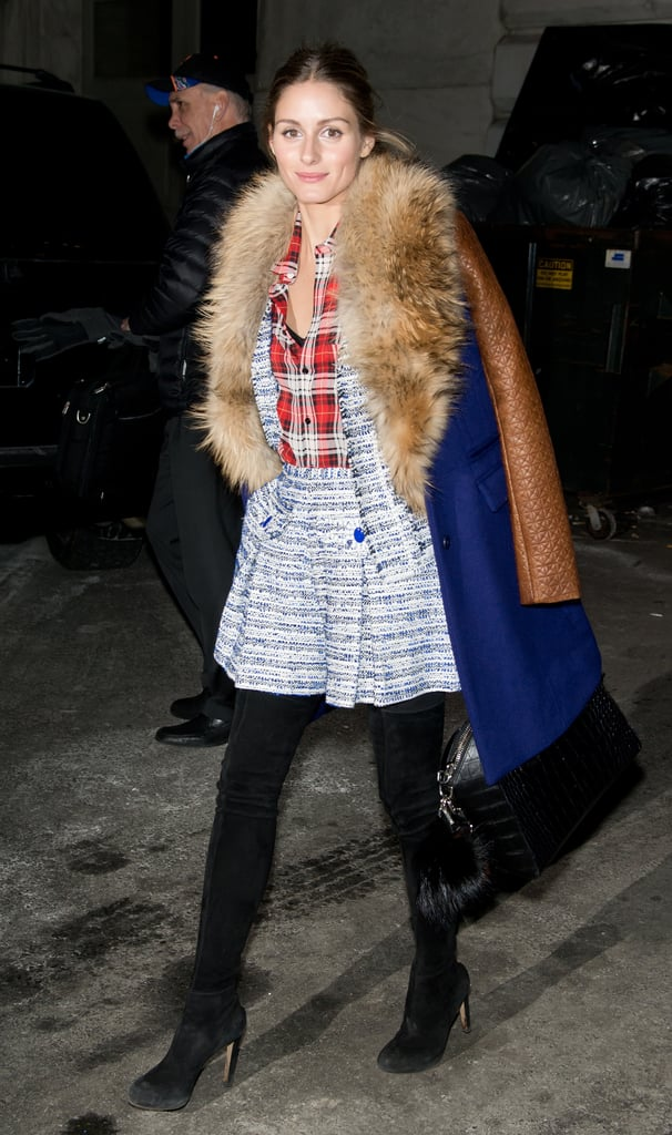 On her way into Marchesa, Olivia topped a tweed short suit and plaid button-down with her cozy and comfy DVF coat.