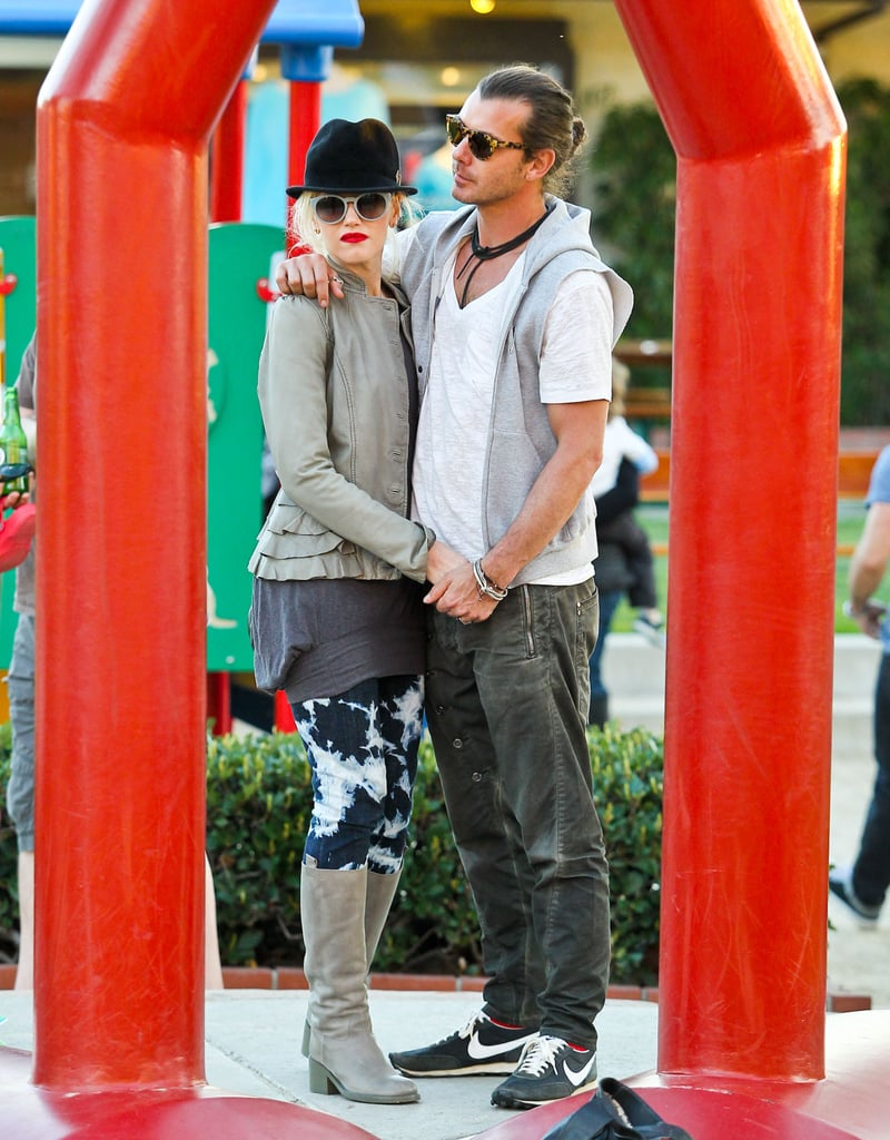 Gavin put his arm around Gwen while hanging with their kids at a playground in LA in January 2012.