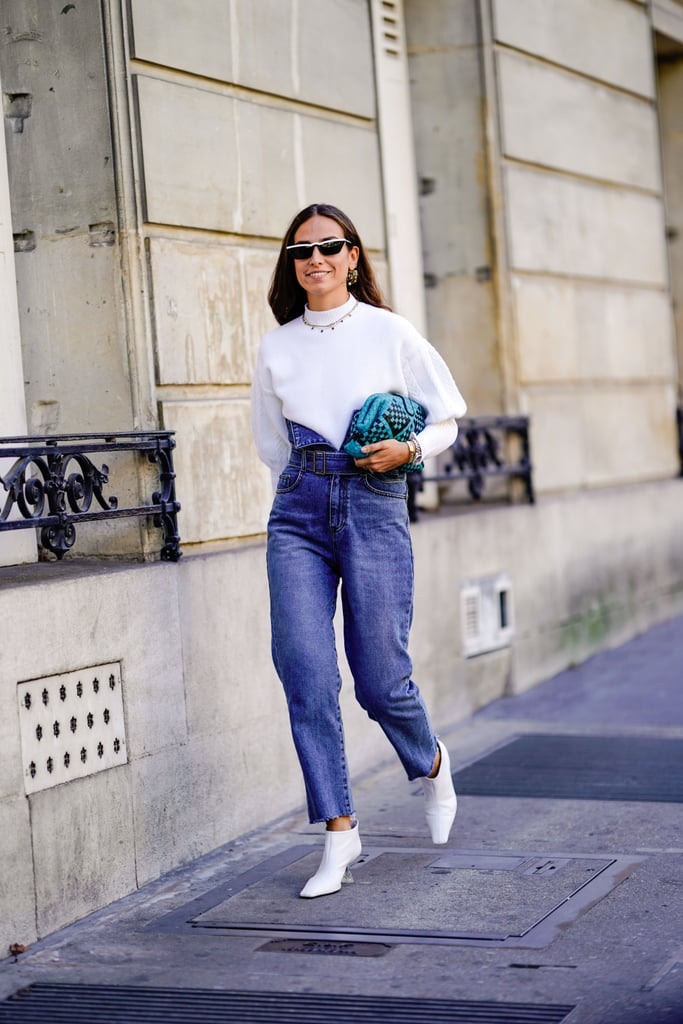Channel your inner '80s girl with waist-cinching jeans and white boots