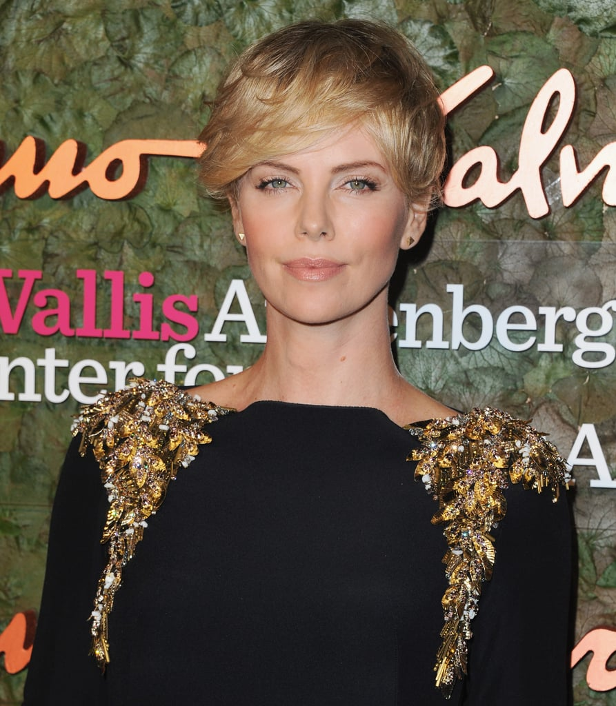Charlize Theron sported a pixie cut with an elegant black gown at the Annenberg Gala.