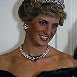 Diana wore the Spencer family tiara and crescent-shaped diamond and sapphire earrings, necklace, and bracelet given to her by the Sultan of Oman during a banquet in Germany in November 1987.