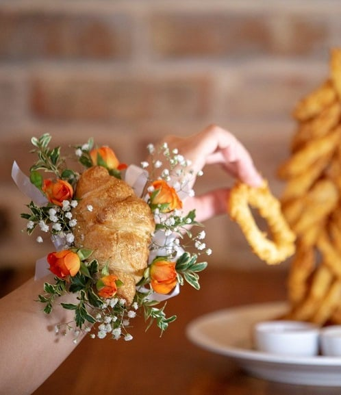 *Taps Mic* Croissant Corsages Exist, So What the Hell Are We All Doing Wearing Wrist Flowers?