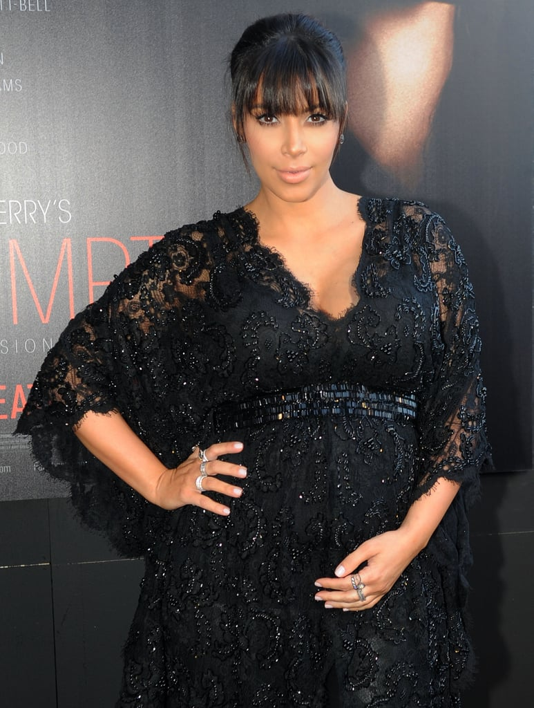 She cradled her stomach at the Atlanta premiere of Tyler Perry's Temptation: Confession of a Marriage Counselor in March 2013.