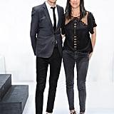 Uri and Rebecca Minkoff looked sleek in black backstage before the designer's concert-like runway show.
