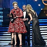 Adele stepped on stage to accept her award for best solo pop performance.