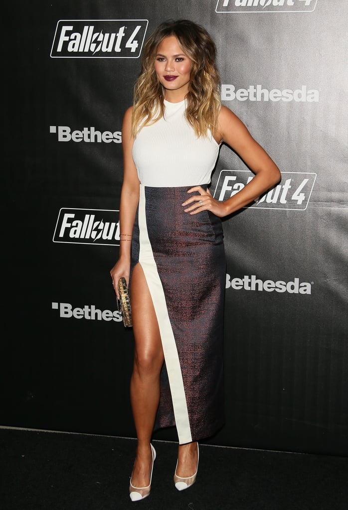 Chrissy dared to bare some major leg in a slitted maxi skirt that she paired with a tight white tank and sheer pumps.
