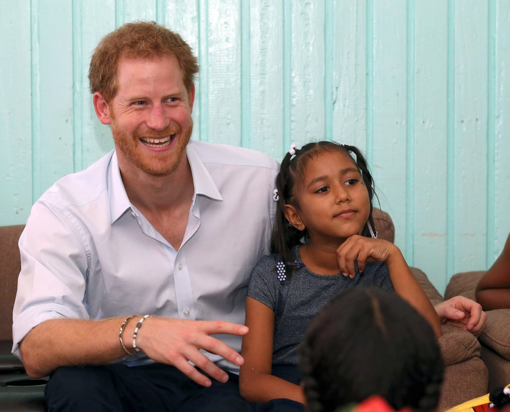 """Prince Harry officially kicked off his Caribbean tour when he touched down at the V.C. Bird International Airport in Antigua on Nov. 20. Upon his arrival, Harry was welcomed by Governor General Sir Rodney Williams and a large banner that read, """"Antigua & Barbuda Welcomes Prince Henry of Wales."""" The following day, the young royal let his hair down with a group of kids at a youth sports festival at Sir Vivian Richards Stadium. On Monday night, he met with Miss Antigua and island beauty queens at a reception hosted by Gaston Browne, Prime Minister of Antigua and Barbuda, before paying a visit to Holy Trinity Primary School and Nursery on Tuesday. He also got his hands dirty when he gutted a fish at Sir McChesney George High School. On Wednesday, Harry arrived in St. Kitts and Nevis, where he chatted with school children, was greeted by cultural dancers at Brimstone Fortress during a youth rally, planted a tree, and released baby turtles into the sea. On Friday, he looked especially gorgeous while playing a rousing game of cricket at a stadium in Castries, Saint Lucia. He then mingled with the public and drank from a coconut. After his stop in Saint Lucia, Harry visited the Botanic Gardens in Kingstown on Saturday and also dropped by the Turtle Conservation Project in Colonarie, where he appeared to have an absolute blast as he played with children. Two days later, the handsome royal showed off his competitive side when he got really into a game of cricket at Queen's Park Ground in St. George's, Grenada. On Nov. 29, Harry paid a special visit to the Nightingale Children's Home in Barbados and was as cute as can be as he met with a handful of kids. The following day, Harry attended the Toast to the Nation event to commemorate the island's 50 years of independence, where he finally got to meet legendary pop princess Rihanna. The two then linked up again for the Man Aware campaign, where they each got a blood test in honor of World Aids Day. On the 13th day of his visit, H"""