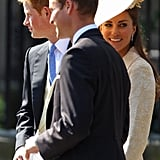 Kate smiles with Zara's first cousins Prince William and Prince Harry.