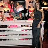 Miranda Kerr wore a sexy slit gown to the store appearance.
