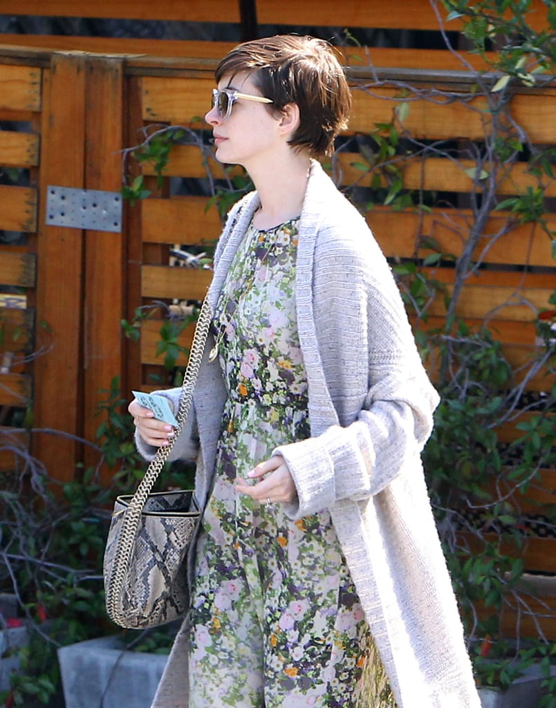 Anne Hathaway paired a snakeskin bag with a floral dress for an LA outing.