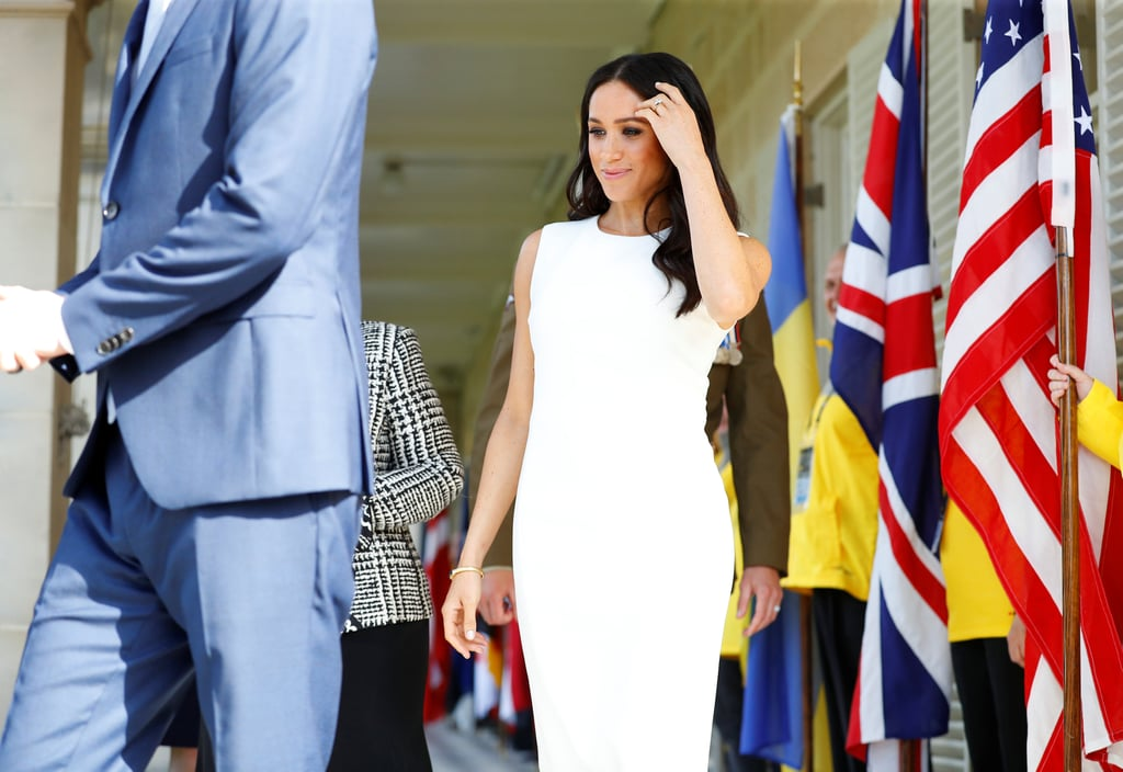 Prince Harry and Meghan Markle have officially kicked off their first royal tour as husband and wife! After touching down in Australia over the weekend, Meghan debuted her growing belly as she and Harry met with Governor-General Sir Peter Cosgrove and his wife, Lady Cosgrove, at Admiralty House in Sydney on Tuesday. The couple were joined by representatives from Harry's Invictus Games and Meghan was positively glowing in a white dress, while Harry looked dapper in a navy suit. Meghan and Harry have a busy day ahead of them! Not only will they get to hang out with some baby koalas at the zoo, but they'll also be catching a ferry to the Opera House, where they'll watch a rehearsal by the Bangarra Dance Company. Harry and Meghan will finally end their night with a reception at the Governor-General's house.  Harry and Meghan's tour comes on the heels of Kensington Palace's announcement that the pair are expecting their first child! Even though we just found out about the news, Harry and Meghan reportedly told the royal family at Princess Eugenie's wedding last week. Congrats to Meghan and Harry!      Related:                                                                                                           Meghan Markle Confided in This Person About Her Pregnancy Before Telling the Royal Family