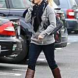 Reese Witherspoon in brown riding boots.