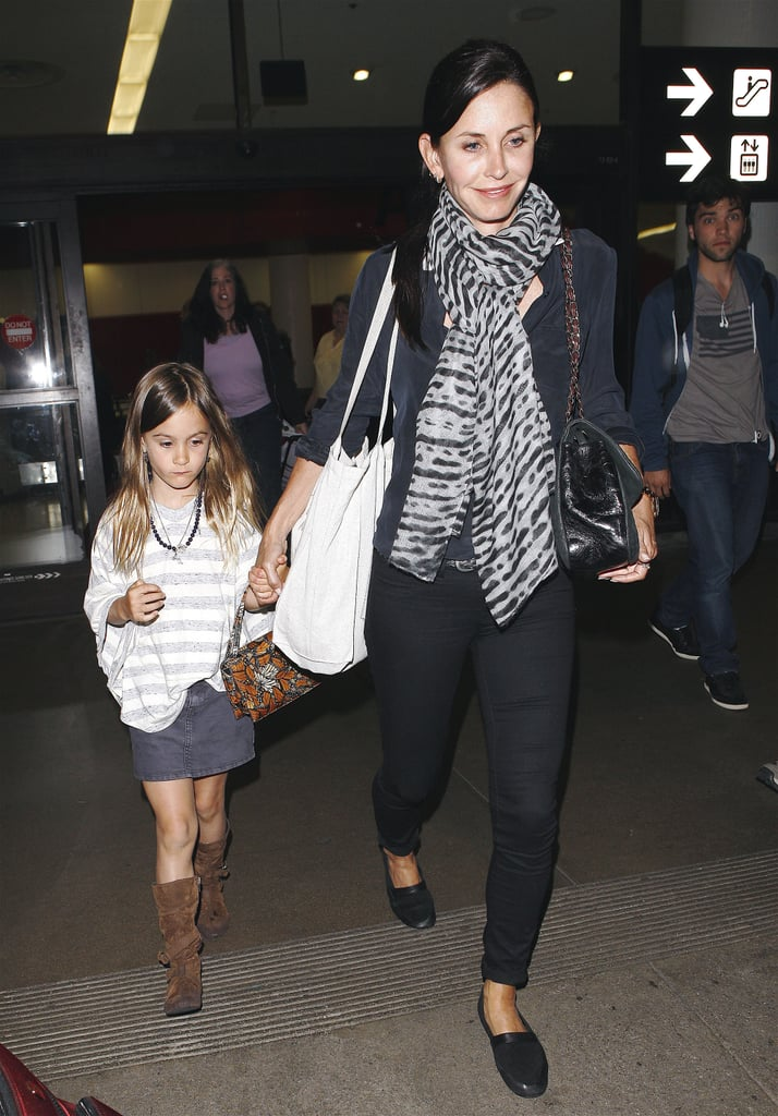 Courteney Cox and Coco Arquette held hands leaving LAX last night. The traveling pair are returning from a week-long vacation that started with a bikini-filled trip to St. Barts with Courteney's Cougar Town castmate Josh Hopkins. The girls left the islands and then traveled to Disney World, where they met up with David on Tuesday for a magical day of family bonding. Courteney and Coco returned home without David, but the Scream 4 stars will reunite Monday night at the premiere of their campy horror flick. Our I'm a Huge Fan corespondent will be on the red carpet so be sure to check back next week! The movie opens April 15, and Buzz wants you to weigh in on which characters you'd like to see live or fall victim to the ghost-faced killer.