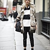 With a Furry Coat, Striped Sweater, and Black Booties