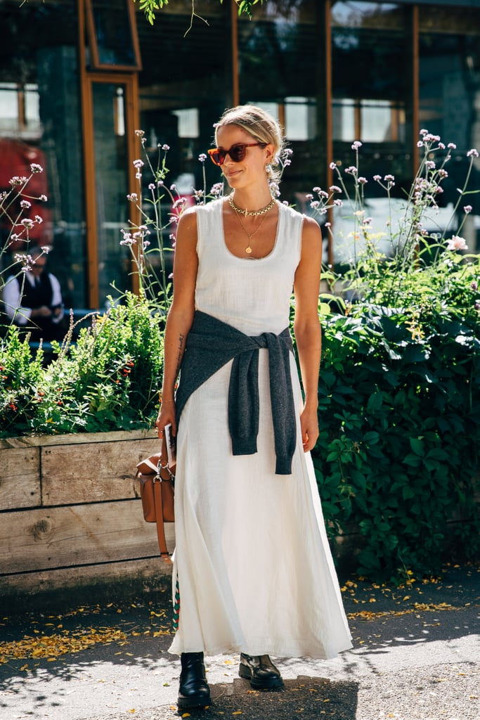 A sleeveless maxi gets grounded with a pair of boots and an added layer.
