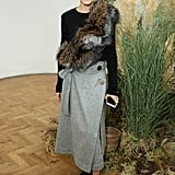 Ever the mix master, Olivia showed her styling prowess, adding a furry finish to a wrap skirt and crew-neck sweater at London Fashion Week.