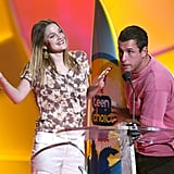 At the 2004 awards, Drew Barrymore and Adam Sandler shared a laugh on stage.