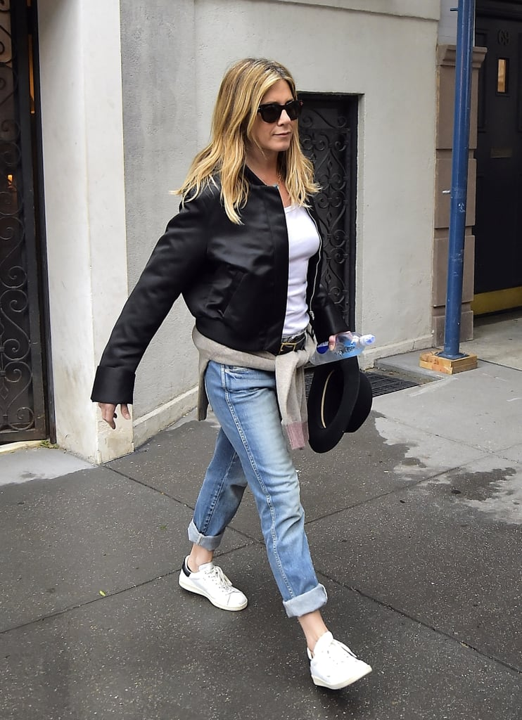 In September 2016, Jen wore her boyfriend jeans with a leather bomber jacket.