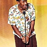 At the 2019 American Music Awards, Tyler kept it casual in a Hawaiian-print shirt, brown shorts, and his go-to Golf Wang hat.