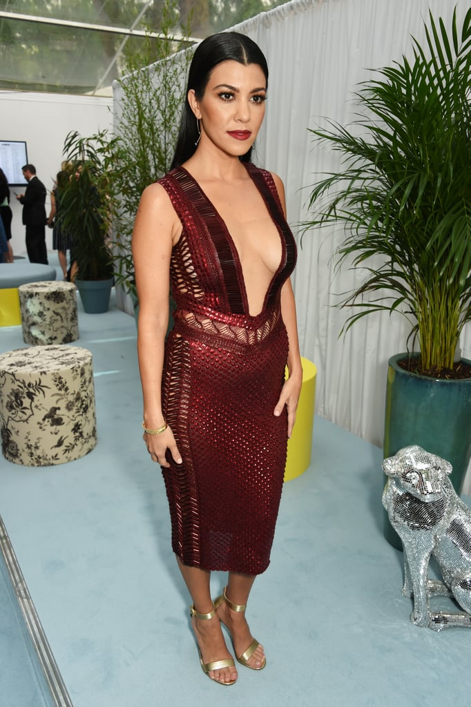 Wearing a Burgundy Dress With a Plunging Neckline