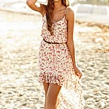 Sweet, sexy, and perfect for your next dinner date.  Delia's Floral Strappy High Low Dress ($45)